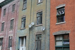 Gentrified (halifaxlight (mostly off)) Tags: canada quebec montreal downtown urban city houses gentrified renovated rowhouses satellitedishes windows bricks colourful architecture terracedhouses