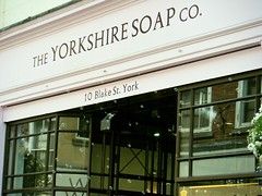 York - soap shop with soap bubble machine sending out fragrant bubbles (rossendale2016) Tags: fragrance lavender rose scent shower body wash hand clean sudsy suds soapy ejecting spurting mechanical automatic present christmas friend grandmother mum girlfriend day mothers presents item lovely numerous small fragrant out beautiful manufactured exclusive outlet centre city riding west street blake company yorkshire marketing excellent ploy advertising iconic clever pavement shoppers pedestrians past walk walking public smelling odour nice scented sending machine bubble retailer shop soap york