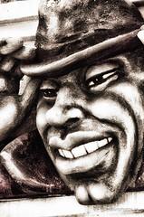 Vive le jazz (Yasur.sur.Flickr) Tags: hat chapeau dent tooth teeth dents noiretblanc bw monochrome montréal montreal africanamerican sourire smile nez nose face visage tête head menton chin nikon d7000 oeil yeux eye eyes gris grey grain portrait sculpture ruesaintecatherine stcatherinestreet quebec québec été summer main hand pouce thumb yasur courbe courbes curve curves lèvres lips joue cheek