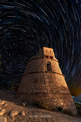 Guardian of the Nigth  .  Startrails on San Miguel ancient Watchtower , Ibiza ... (Anton Calpagiu) Tags: ibiza balearicisland espana spain night seascape sky moon moonlight light sea mediterranean island serene calmwater longexposure shore mountain nightsky starpaths startrails stars startrail trackingstars astronomy beauty dawn dusk environment idyllic illumination landscape nature nightime outdoor scene silhouettes tranquil tree trees wilderness sanmiguel watchtower tower ancient old