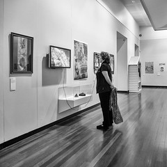Appreciating Art 022 (Peter.Bartlett) Tags: square noiretblanc art people city olympuspenf australia victoria peterbartlett woman urban lunaphoto monochrome urbanarte m43 microfourthirds streetphotography bw standing wall blackandwhite niksilverefex candid ballaratcentral au