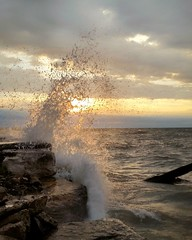Water's up (ossington) Tags: sunlight sunrise bigwaves breakwall lakeshore