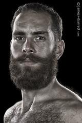 Abdulrahman Alhalawani (2017) (james m barrett) Tags: harshbeautiful male maleportrait intense portrait desaturated strong masculine beard bear pride lgbtqia handsome