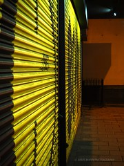 The Rattle-Tin Shutter (Mars Mann) Tags: nightphotography composition abstractphotography lightshadow shadow streetphotography urbanphotography urbanstreets yellow shining light nocturnal marsmannphotography london londoncity photography olympusem1 microfourthirds flickr