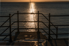 DSF_2077.jpg (alfiow) Tags: fishingrod railings sunset totland