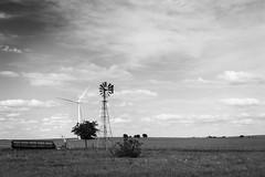 Old and New (brian.a.eaton) Tags: windmills windfarm pasture prairie farmequipment farmland texas skies clouds landscape scenery power daylight greenpower nikon d750 wind turbines