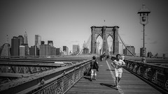 Walk over the Brooklyn Bridge (Juergen Huettel Photography) Tags: light jhuettel newyork street brooklyn bridge sw river blackandwhite old people tourism