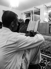 Koran recitation (A. Yousuf Kurniawan) Tags: blackandwhite monochrome moslem islam mosque dailylife people activity recite culture reading cameraphone streetphotography cameraphonestreet phonestreet man urbanlife