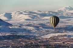 Over Cappadocia (C McCann) Tags: turkey cappadocia kapadokya hot air balloon hotairballoon flying flight sunrise snow mountains nevsehir