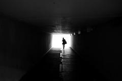 Alone (maekke) Tags: zürich wollishofen underground tunnel woman noiretblanc bw silhouette fujifilm x100t streetphotography symmetry urban highcontrast 2017 switzerland ch 35mm
