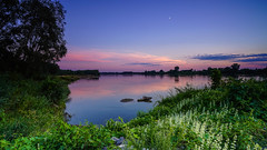 The colours of dusk (SpectrumLight) Tags: dusk twilight colour landscape river waterscape riverbank scenic scenery sonyilce7m2 sonya7ii sky moon bluehour pink blue flickr fe1635mmf4zaoss natural nature explore
