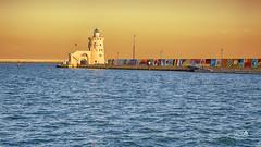 Puerto Sherry (Spain) (Marcial Carretero) Tags: puertodeportivo marina elpuertodesantamaría port cádiz andalucia andalousie andalusian españa spain espagne faro lighthouse mar sea phare leuchtturm puerto océano ocean litoral rompeolas orange naranja blue azul