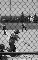 Kate Burton2 (byuiphotography) Tags: photography narrative blackandwhite field softball team runner batter ball byui