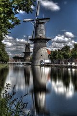 Two Mills (Rik Tiggelhoven Travel Photography) Tags: windmill mill noord vrijheid ndfilter nd filter longexposure long exposure neutral density reflection reflectie water hdr scenery landscape schiedam holland netherlands nederland europe europa canon 6d fullframe full frame ef24105mmf4lisusm clouds reed tree rik tiggelhoven travel photography