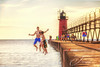Visitors (The Shutter Affair) Tags: southhaven michigan michiganlighthouse lighthouse lakemichigan kids pier jumping swimming summerfun off jump beach water schoolsout family splash postcard vintage