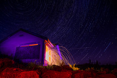 Leftover energy (Graveyardworker) Tags: bclightart graveyardworker jordanriver lpwa lightpainting shadowplay startrailstacks abandoned adventure art bc canada colours dark exploration fire flames graveyardwork house light lightart lightscape longexposure lpwalliance night nightlights nightphotography nightscape outdoors pacificnorthwest paintingwithlight space sparks startrails stars steelwool trippy ubex urbex illuminated energy