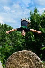 It's a Bird...It's a Plane... (gendarme02) Tags: flying hay bale man gymnastics flip