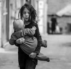 He ain't heavy (and even if he is then what?) (ybiberman) Tags: israel jerusalem meahshearim girl baby carrying portrait candid streetphotography bw blackandwhite