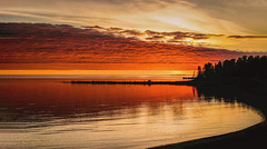 Red Sky at Night... (T P Mann Photography) Tags: eos canon michigan atwood breezeway silhouette tree trees skyline seascape reflections water lake sea horizon color dusk evening shore beach sky clouds glow red sundown sunset sun