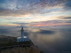 Lighthouse In The Mist. (dasanes77) Tags: landscape seascape cloudscape mist fog morning bluehour sunrise sea ocean sun clouds lighthouse formentera
