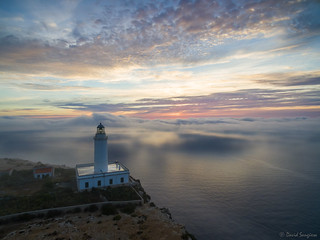 Lighthouse In The Mist.