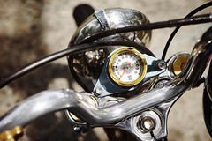 Custom Harley in detail (Eric Flexyourhead) Tags: vancouver canada britishcolumbia bc strathcona strathconapark eastvan eastvancouver theshop 2017 spitnshine 2017spitnshine detail fragment motorcycle motorbike bike american harleydavidson harley custom modified chrome metal shiny reflections instrument gauge speedometer handlebars shallowdepthoffield bokeh sonyalphaa7 zeisssonnartfe55mmf18za zeiss 55mmf18