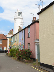Just the average street scene (Harmonious Discord) Tags: southwold lighthouse pastelcolours street