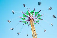 Go around (matthew_image) Tags: 2017 sony a7 nikon nikkor 35mm f14 14 blue sky japanese style skies fair fairground circle swing swings people game carnival ais ai light lightroom