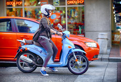 Sweet Ride (Ian Sane) Tags: ian sane images sweetride woman kymco people scooter light blue candy store southwest 6th avenue alder street candid photography downtown portland oregon canon eos ds r camera ef70200mm f28l is usm lens