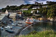 Postcard from Cornwall (suerowlands2013) Tags: cadgwithcove westcornwall thelizard fishingboats fishermanscottage eveninglight beach cove clouds water sea thatchedcottages