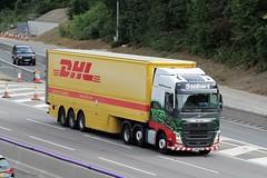 KX66 NDO - EDDIESTOBART - VOLVO DHL (GAZ SELLERS) Tags: truck rig lorry driver motorway tarmac busy william yellow rivals contract black red green volvo southbound 17 m1 dhl stobart eddie