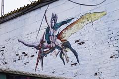 Taarna the Taarakian (Keith Kelly) Tags: bigapple bikini brooklyn gotham graffiti keithkelly metropolis mural nyc newyork newyorkcity taarakian taarna terrasaur art design flying keithakelly paint pterosaur reptile spear streetart weapon unitedstates us