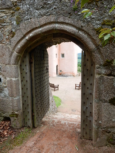 Craigievar Castle through a garden door
