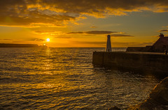 Watching The Sun Go Down (williamrandle) Tags: cullen northeastscotland scotland moray banffshire uk 2017 summer sunset harbour sunburst reflections lighthouse beauty sky clouds lowlight tamron2470f28vc nikon d7100