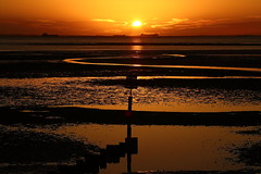 Dawn reflections (alan.irons) Tags: humberestuary humber sunrise dawn cleethorpes northeastlincolnshire morning orangeskies sea shoreline breakwater ships england idyllic river tidal shipping sun sunlight reflections canon 100400mm