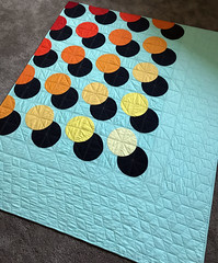 Misprint quilting (Quiltachusetts - Heather Black) Tags: modern contemporary quilt design geometric solids aqua red orange navy shadow 3d matching binding heather black quiltachusetts