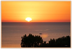 Tramonto Pizzolungo (Luciano Schano) Tags: picmonkey tramonto sunset sonyilce6000 ilce6000 sonyemount55210mediterraneo mare barca pizzolungo trapani sicilia italia paesaggio sonyemount55210 mediterraneo rosso arancione sole