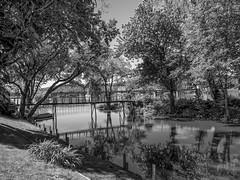 Wooden Bridge in Lambertville (vodophoto's images) Tags: blackandwhite bridge seascape water reflection olympus