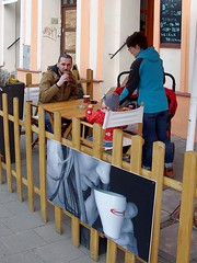 Coffee break (Jumpin'Jack) Tags: man drinking coffee imitating pose ofthe woman ona advertising poster child table cafe candid street photo town city olomouc czech republic blackboard chalkboard