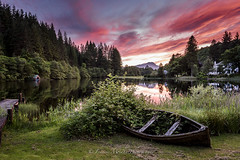 Loch Ard (Francis Mridha) Tags: stirling trossachs beautifulscotland boat clouds francismridhaphotography landscape loch lochard longexposure nikon perthshire redsky reflection scotland sky sunset travel visitscatland water