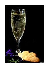 Bubbly And Lavender Shortbread (paulinecurrey) Tags: stilllife lavender shortbread bubbly glass purple bubbles fizzy food drink arrangement