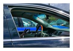 HandHeld (TooLoose-LeTrek) Tags: lx100 car man vehicle phone hand steeringwheel blue banal voyeur