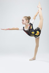 Caucasian Female Rhythmic Gymnast Athlete In Professional Competitive Suit Doing Vertical Split  Exercise While Posing in Studio Against White. (DmitryMorgan) Tags: 1 711years active aerobics art artistic athlete beautiful bend body bodysuit caucasian champion child childhood colorful dynamic elegant exercise female fitness flexible gimnastika girl grace gymnast gymnastics healthy individual lady lifestyle one preschooler professional rhythmic rhythmicgymnastic rhytmic split splits sport sportswear sportswoman sporty stretching studio training wellbeing wellness