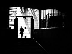 out of the darkness (Sandy...J) Tags: street streetphotography silhouette atmosphere alone architecture monochrom man blackwhite urban noir darkness light black white city