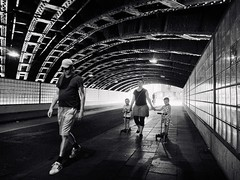 Family trip (gerhardkörsgen) Tags: atmosphere artphotography alltag blackwhite candid city cologne decisivemoment everyday eigelstein gerhardkoersgen germany grafic köln life look menschen monochrome melancholy outdoor people perspective photographed streetphotography scene schwarzweiss tunnel unterführung urban view walkby family trip