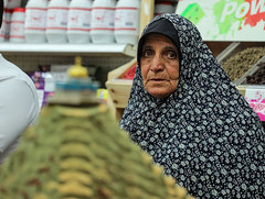 Bellow and behind all our wishes for a Temple lies a wish for a bread, hyssop, and onion. (ybiberman) Tags: israel jerusalem oldcity alquds muslimquarter woman hijab hyssop heap domeoftherock model spiceshop candid streetphotography