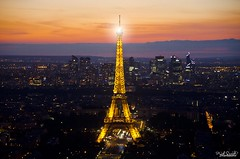 Eiffel n the City Lights !! (Piyush.Saxenaa) Tags: nikon nikond5100 d5100 piyush piyushsaxena piyushsaxenaa psphotography europe eurotrip travel traveller nationalgeographic traveldiaries paris eiffel eiffeltower france evening night sky orange city buildings 18105