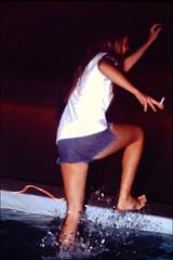 Splash (fillzees) Tags: night girl woman wet shorts student candid water fountain mu cutoffs barefoot teeshirt dark splashing
