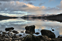 Forgotten Fragments Of Yesterday (jeanette_lea) Tags: sunrise dawn winter derwentwater the lake district cumbria rocks reflections water light snow mountains sky clouds colours
