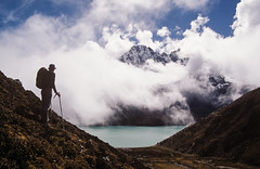 Gokyo Lakes (robertdownie) Tags: sky landscape lake mountains water nature travel blue clouds rock person white green climb mountain nepal valley himalaya outdoors daylight hiking himalayas trekking fluffy adventure scenic hike azure peak gokyo